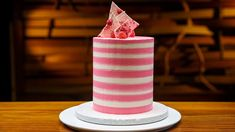This vibrant layered vanilla birthday cake is stacked with sweet swiss meringue buttercream and is topped with raspberry and white chocolate bark. MasterChef Australia, Season 10, Pressure Test
