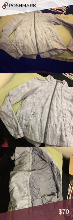 "Euc 10 lulu windbreaker jacket I don't know stile name of this- if you do, please lmk! It's in excellent condition only worn a handful of times, windbreaker material with mesh and zipper pockets and inside pocket to stash a key and run headphone cord through. I'm quite sure it's a 10, though I couldn't find a dot.. it measures 18.5"" pit to pit as shown in photo. Will best fit a medium or 8/10 in my opinion. Grey floral pattern, gorgeous jacket! lululemon athletica Jackets & Coats"