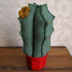 This cute plush cactus needs no sunshine or watering! I made this from felted recycled wool sweaters and gave it dimension by stuffing it with