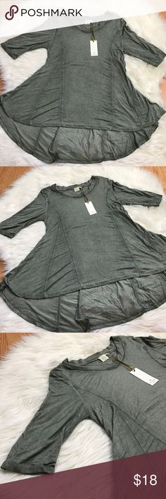 """NWT Saint Tropez West Asymmetrical Blouse NWT Saint Tropez West green mid sleeved blouse in a size small. Blouse is longer in the back than the front (asymmetrical). Blouse is in excellent condition with no stains, rips, or snags. Measurements are approximately while lying flat: 30.5"""" at its longest, 18.5"""" from armpit to armpit, 13.5"""" sleeve length. Feel free to ask questions! Saint Tropez West Tops Blouses"""