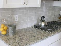 Kitchen Backsplash Grey Subway Tile dramatic kitchen make-over - white subway tile and black pencil