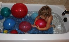 Food coloring filled water balloons in the bathtub.  Let them pop for fun bursts of color.
