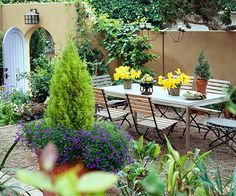 Put every square inch of your backyard to work by removing the sod to create useable outdoor living spaces. In this small courtyard, the turf was torn up and replaced by a gravel base that supports a gorgeous dining table and flower-filled containers. Plus, the homeowners have a lot more time to enjoy the space because they no longer have to mow.