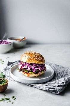 Fiery Jerk Chicken Sandwiches with Creamy Avocado, Crunchy Red Cabbage Slaw and a Tangy BBQ Sauce.   - The Maker Makes