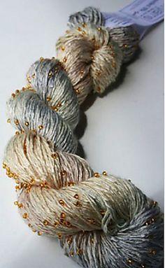 Artyarns Beaded Silk Light. This would make an incredible scarf...