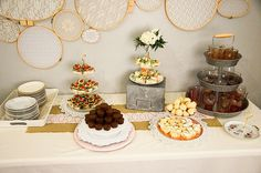 Vintage China and a custom embroidery hoop backdrop set the tone for this Shabby Chic Baby Shower