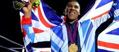 Anthony Joshua celebrating with his Olympic gold medal
