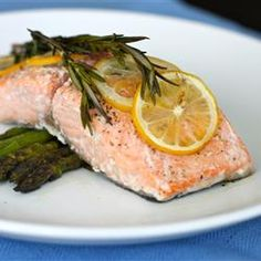 Lemon Rosemary Salmon Allrecipes.com  ...made this for dinner tonight...so easy and good.  We baked it wrapped in foil as one of the reviewers suggested.