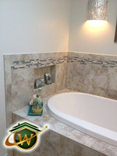 custom built drop in soaking tub installation with wall niche and ambient lighting creates a serene bathing experience ambient lighting creates