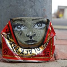 """As part of his Free Art Friday movement, the """"Can Man"""" leaves portrait art on the street for any finder to grab and enjoy—for free."""