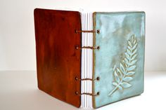 leaf imprint ceramic artist journal - walnut coptic binding by etsy artist katehust .. something like this in polymer clay?