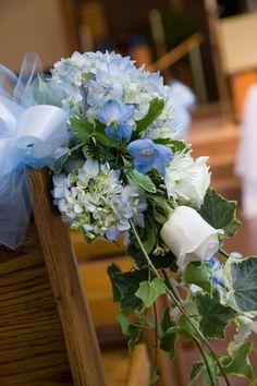 Wedding flower pew arrangements.