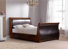Bruges Bed Frame - Our Bruges sleigh bed is constructed in hard solid wood which is complimented with soft faux leather for a high-end sophisticated looking bed.