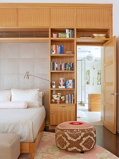 A clean-lined storage unit steals the show in this contemporary-style bedroom: http://www.bhg.com/rooms/bedroom/master-bedroom/beautiful-boudoirs/?socsrc=bhgpin032514modernbohemian&page=12