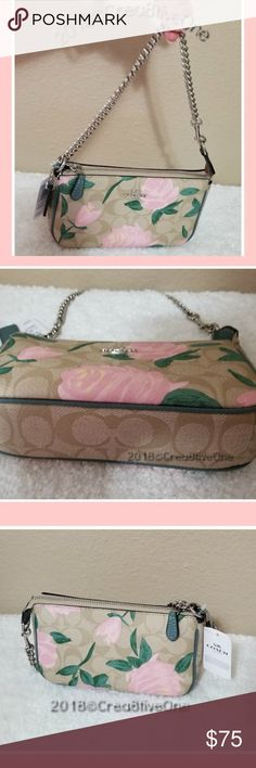 """AUTHENTIC Coach Wristlet - Floral (Pink flowers) Authentic - BRAND NEW! COACH leather Wristlet with chain.  Gorgeous Pink flowers and signature coated canvas monogram in tan. Features: Two credit card slots, silver tone chain, Inside multi-function pocket, zip-top closure, fabric lining in green. Size:  Approximately 7 1/2"""" (L) x 4 1/2"""" (H) x 2"""" (W) New!! With Tags and Care instruction card.  In Coach box with coach tissue paper! I have two available.  Flower placements vary. Please ask…"""