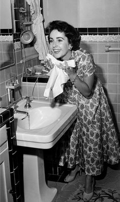 Washing her face in 1948.