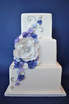 I like the purple flowers on the white, but I'm not sure about the square cake