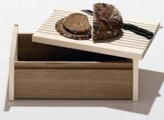 Side by Side Bread Box...lid can be used as a cutting board or tray. made by a non-profit organization that helps the disabled.