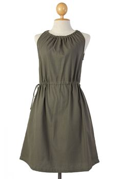 This adorable sleeveless dress is both playful and sexy with its gathered neck line, drawstring waist and simple sleeveless style. The gathered fabric gently accentuates your curves while the adjustable neckline finishes at a sexy daring reveal. Adjust neck and waist for a wonderful comfort fit, plunge your hands in the hidden pockets and you'll feel as lovely as you look.