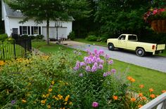 On left is pool, beyond truck are hydrangea's, in front is kitchen garden with phylox, black eyed susan, daylillies, etc.  Grass is St. Augustine