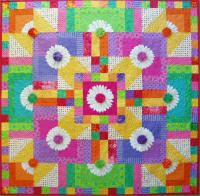 """Petal perfect yo-yo's punctuate this colorful palette of fresh white daisies. Finished Size:  48"""" x 48"""""""