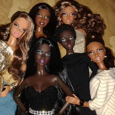 Assorted black Barbies including a couple of the Barbie Basics