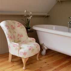 White freestanding bath and floral armchair