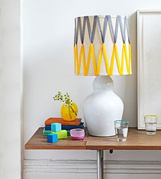 Weave ribbon around a plain lampshade to add color and interest to your bedroom table.