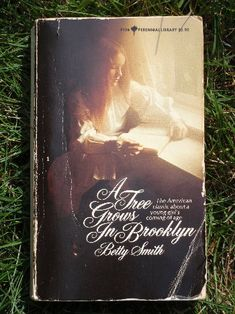 A Tree Grows in Brooklyn by Betty Smith~ My exact copy from high school...I still have it torn and tattered and written in. Treasured...