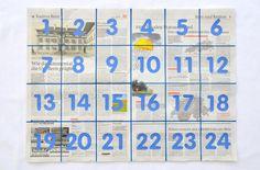 Vier Zeitungsbogen aufeinander legen, flach streichen,  an den Aussenrändern mit Büroklammern fixieren. Auf dem obersten Bogen mit Markierstift ein Gitter mit 24 Teilen aufzeichnen. Zahlen aus Papier ausschneiden und aufkleben oder diese mit Markierstift auftragen.