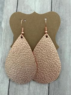 Rose Gold Leather Teardrop Earrings! So Beautiful! Shimmer and shine rose gold leather. Size: 2 1/4in x 1 3/8in Every piece of leather is unique in color, size, design. Beautiful colors and styles that can be paired with any outfit. Handmade with love ❤️ in Kansas  My leather earrings are