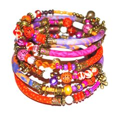 RESERVED - Custom order for Heaven: Orange, purple, pink and bronze adjustable wrap bracelet with glass and handmade fabric beads by PurpleTurtleStore on Etsy https://www.etsy.com/au/listing/236096401/reserved-custom-order-for-heaven-orange