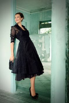 Strapless tea length dress and Organza coat with 3/4 sleeve by Living Silk.