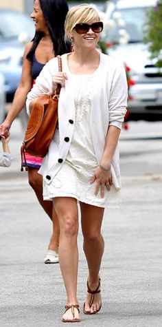Look of the Day › April 30, 2011 WHAT SHE WORE Witherspoon stepped out with her family in a white dress and cardi, Stuart Weitzman T-strap sandals and a brown satchel.