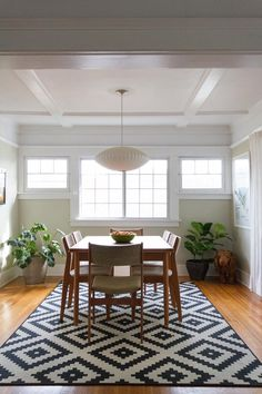 Mid-century table and chairs: Rose Bowl flea market George Nelson bubble pendant lamp: Modernica Rug: IKEA