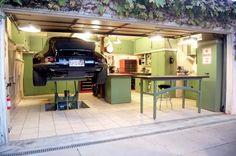 hydraulic lift in your own home garage | Jack Olsens 12-Gauge Garage