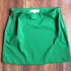 """Michael Kors Green Mini Skirt Adorable MK mini skirt! Features 2 gold zippers on each side of skirt! Size 2. 70% polyester, 25% rayon, 5% spandex. Measures 14"""" from top to bottom. Michael Kors Skirts Mini"""