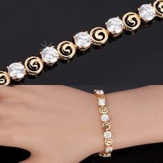 18K Real Gold Plated Luxury Clear AAA Cubic Zirconia Jewelry Chain Bracelet. Setting Type:Prong Setting   Material:Cubic Zirconia   Length:19 CM   Clasp Type:Double-safety-clasps   Metals Type:Gold Plated   Shape\pattern:Round   Bracelets Type:Chain & Link Bracelets    Enjoy Domestic Delivery!It only takes 2 - 7 business days for the item to arrive to US.
