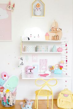 How sweet is this girls room?One lucky little girl! Serious shelf envy; I love the pastel colour scheme