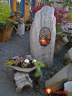 garden lighting # DRIFTWOOD ART -Even tho this has a glass insert , I think just the oval cut out would be good, amp; or a piece of wirenetting with some tucked in.(Fused glass light in driftwood with driftwood planter(-jbell) Driftwood Planters, Driftwood Projects, Driftwood Art, Garden Crafts, Garden Projects, Light Crafts, Garden Planters, Log Planter, Yard Art