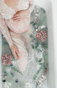 Look no further for the perfect maternity photo shoot idea! Milk bath photography is beautiful and relaxing.