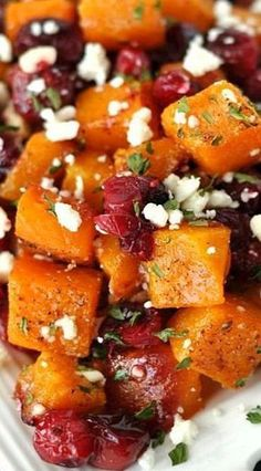 Honey Roasted Butternut Squash with Cranberries and Feta. Use vegan feta or omit cheese to make this vegan Side Dish Recipes, Veggie Recipes, Vegetarian Recipes, Cooking Recipes, Healthy Recipes, Christmas Vegetable Recipes, Roasted Vegetable Recipes, Banting Recipes, Clean Eating