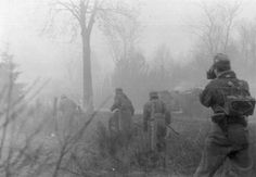 German cameraman filming advancing soldiers during the opening stages of Unternehmen Wacht am Rhein, aka Battle of the Bulge, December, 1944