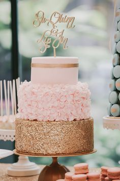 Tiered gold and pink wedding cake with ruffles and laser cut cake topper // Hall of Mirrors: Jin and Su's Glamorous Wedding at the Grand Hyatt Kuala Lumpur {Facebook and Instagram: The Wedding Scoop}