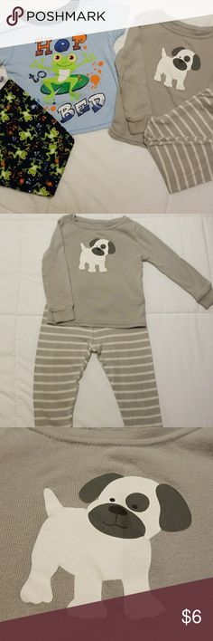 2 sets of Boys PJ's. Frogs and Dogs. Size 18 mnths 1st set of Pj's is a two piece with short sleeves frog set.  The back ground is light blue on top and dark blue on the pants.  There is one spot on the top that is a little more worn looking but you can see it in the picture above.  The pants are super cute with frogs all over them.  This sleepwear is by Garanimals.  The 2nd set of PJ's has long sleeves and is adorable with the grey background and the little puppy on the front. This is made…