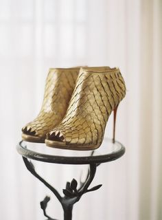 Gold Christian Louboutin booties: http://www.stylemepretty.com/2015/06/16/wedding-day-shoes-worth-showing-off/