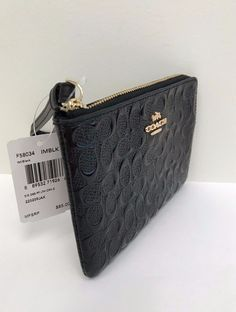 3605bd4753130 NWT Coach Signature Debossed Patent Leather Corner Zip Wristlet F58034 -  Black  33.0