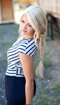 I really love the Fish tail braid and beach blonde hair..it looks good against the navy blue outfit