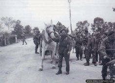 """Soldiers from the 1st Special Service Brigade crossing the Ranville bridge (""""Euston II"""") defended by the men of D Company, 2nd Ox & Bucks, 6th Airborne Division (© DDay-Overlord)"""