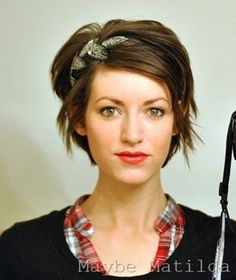 Cute and playful...I LOVE this haircut!!!  UGH...I wish I knew I could pull it off w/ my face... :(